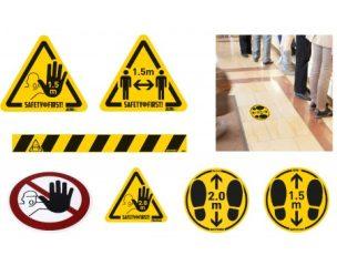 Figyelmeztető matricák és szalagok fertőzés elkerüléséhez és távolságtartáshoz